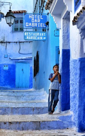 A boy in blue in lovely blue town , Chefchaouen